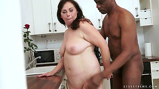 Curvy housewife sits her snatch down on a big black cock