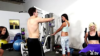 Two brunette babes banged in the gym