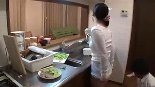 Making love in the kitchen behind her husband