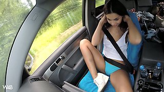 Stunning young hottie Sabrisse is playing with boobs and cunt in the car