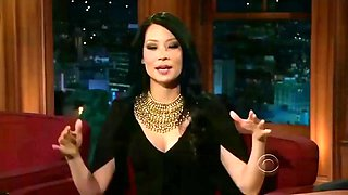 lucy liu - craig teaches her how to blow the mouth organ