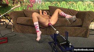 Cute brunette Ashli Orion sucks on a fake cock