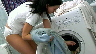 Perverted teen in white panties masturbates pussy on a washing machine