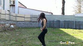 Brunette sweetheart shows her strong urine spray method
