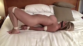 carissa hogtied on the bed