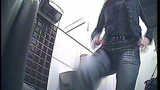 Redhead stranger white girl in the public restroom filmed from behind