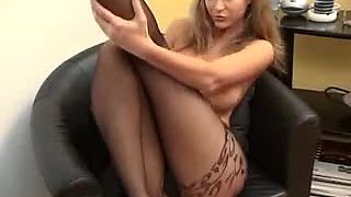 Busty Milf Puts On Pantyhose