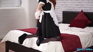 Seductive redhead maid Jayne gets rid of her clothes