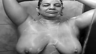 busty mature aunty bathing