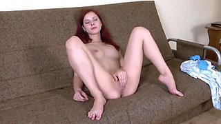 After performing striptease she masturbated on the couch