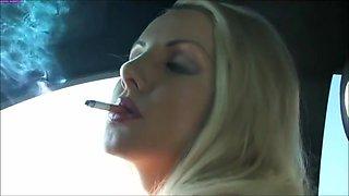 Danni smoking in her car