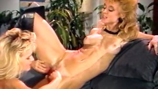 Marvelous blonde sexy babes tease each other on the sofa