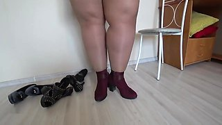 Thick legs in nylon try on shoes with high heels.
