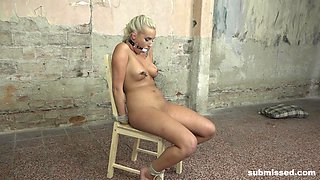 Daisy Lee gets her tits clamped and pussy abused with toys in bondage