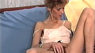 Sexy and lean white lady on the couch opens her legs and masturbates