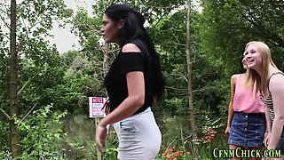 Clothed dominas outdoors