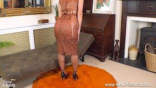 Busty brunette Roxy Mendez strips and wanks off in vintage nylons garter suspenders stilettos