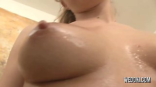 Oiled babe playing with her pussy
