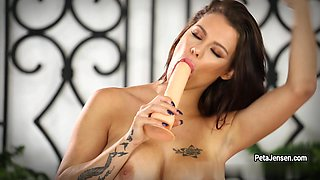 Peta Jensen has some fun alone with her toys. She sucks and fuck her dildo!