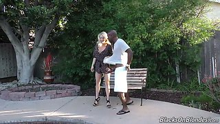 Blond hottie Katie Morgan sucks BBC of her buddy on the bench in the yard