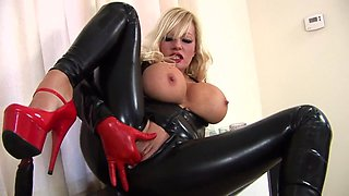 Blonde in latex plays with dildo.