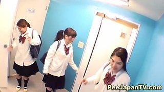 Pissing Asian teen schoolgirl has been very naughty
