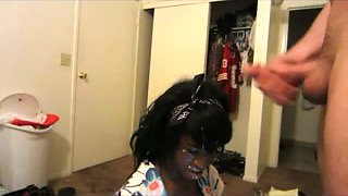 Ebony maid kneels in front of me and lets me cum on her face