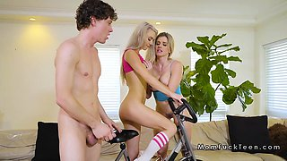 Threesome with Milf on a gym bike