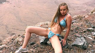 Ukrainian nympho Angel B climbs the rock specially to masturbate her twat