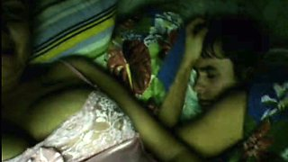 Naughty Russian mom showing her tits on cam while her hubby is sleeping