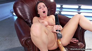 Shaved babe fucks machine and cums