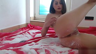 Cutie plays with her clit