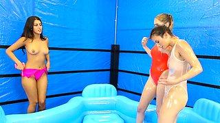 Lesbians in bikinis had oil wrestling