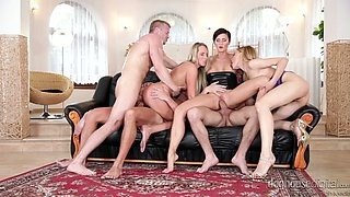 Trio of hot swinging vixens share their boys on big couch in orgy