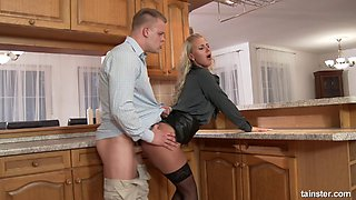 Tight leather skirt and blouse on a babe fucking in her kitchen