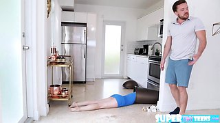 Tiny Bambi Black sucks a big hard cock in the kitchen