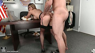 Boobalicious police officer is banged hard doggy style in the office