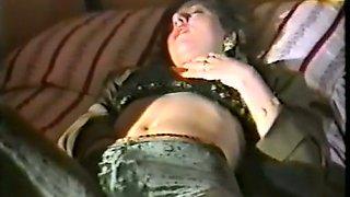 Marvelous vintage brunette lady on the bed pleasuring herself