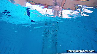 Beautiful amateur gal enjoys nude swim show in the pool