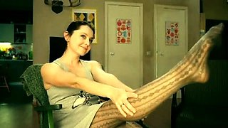 Provoking camgirl in stockings reveals her sexy long legs