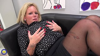 Freckled mature blonde MILF Gina O. plays with her boobs at the office