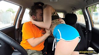 Tight tattooed babe fucked by driving instructor in the car