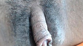 Beautiful Rachel plays with her meaty clit