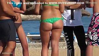Girl in green bikini with sexy ass