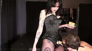 Slave eats cake off Mistress Petra's strap-on