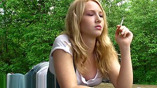 Pink angel smoking outside