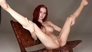 Svelte rather flexible redhead Helga Grey has got inviting tight pussy