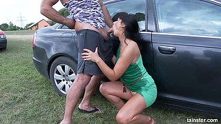 busty milf enjoys sucking and riding outdoors by the car
