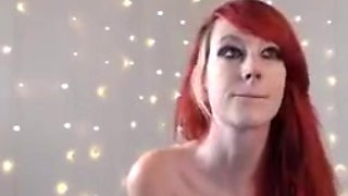 Tatooed red head shaved cameltoe pussy pert tits teasing