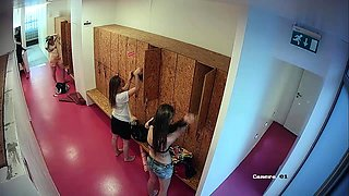 Locker room voyeur finds sexy babes changing clothes